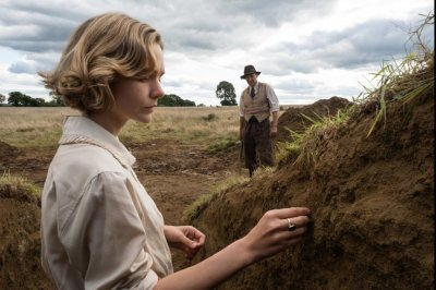 'The Dig' photos show Ralph Fiennes, Carey Mulligan search for riches