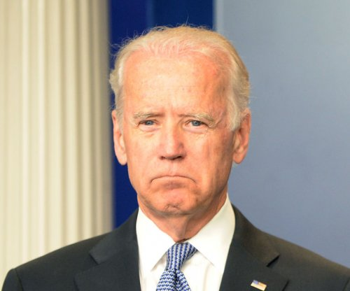 Biden joins mourning Charleston church goers, shares loss of his son