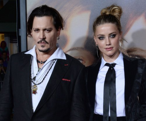 Amber Heard claims Johnny Depp hasn't paid divorce settlement