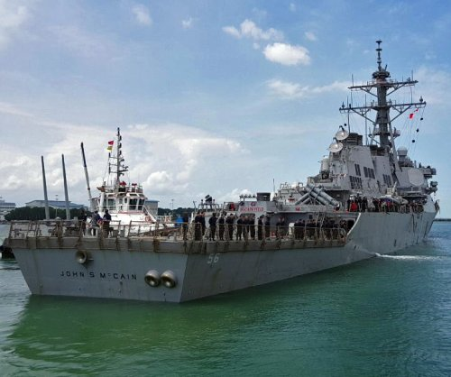 USS John S. McCain arrives at naval base after collision; 10 sailors missing