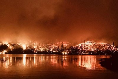 California wildfire doubles in size, five dead