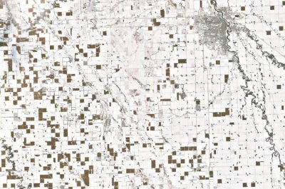Checkerboard of unharvested corn in snowy North Dakota seen in NASA image