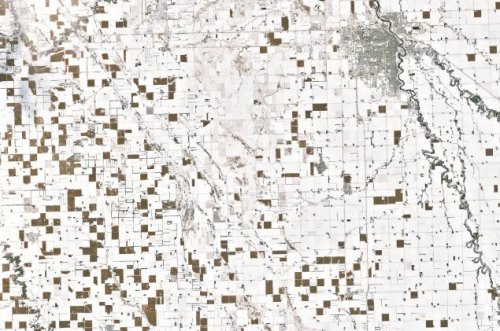 Checkerboard of unharvested corn in snowy North Dakota seen in NASA image