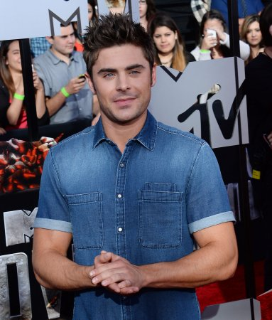 Zac Efron goes shirtless at the MTV Movie Awards