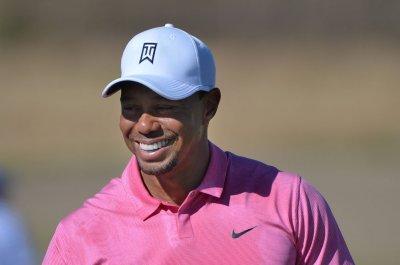 Tiger Woods trails Roy Ishikawa by three in Quicken Loans National