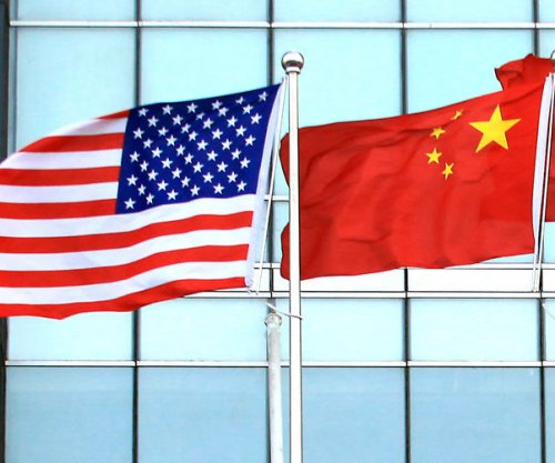 U.S. expands health alert to cover China after mystery illness