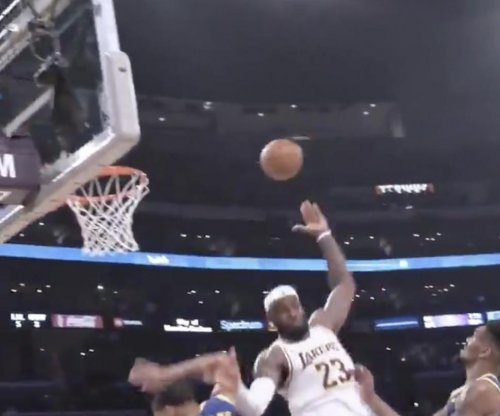 Lakers' LeBron James gets circus assist for 3-pointer