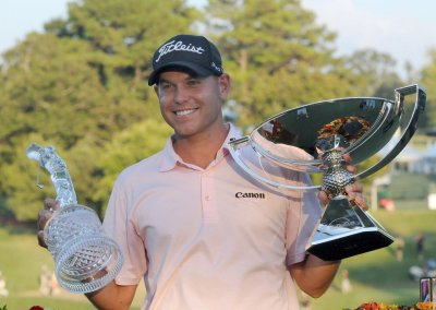 Haas wins Tour Championship, FedEx Cup
