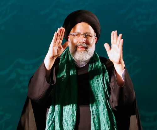 Iran's mullahs choose executioner as front-runner for president