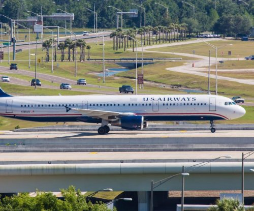 Hoax bomb threat made against several airliners, prompts US Airways flight evacuation