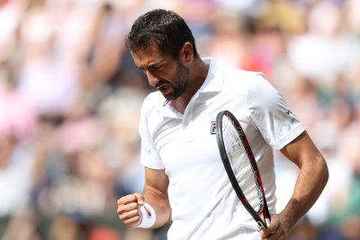 Wimbledon: Marin Cilic outlasts Sam Querrey to reach final