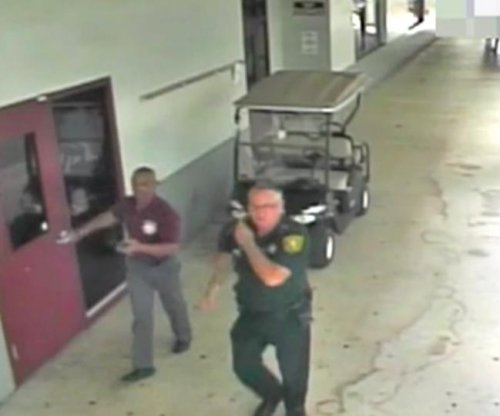 Surveillance video shows events outside Florida school shooting