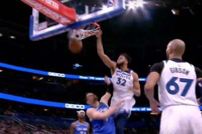 Karl-Anthony Towns flies for poster dunk on Magic 7-footer