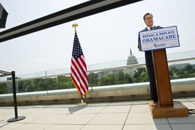 Report: More uninsured under Romney plan