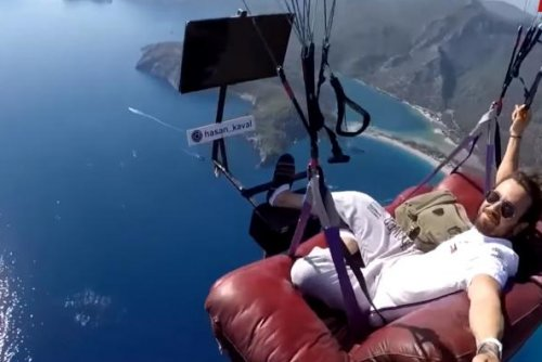 Turkish paragliding instructor takes couch, TV into the sky