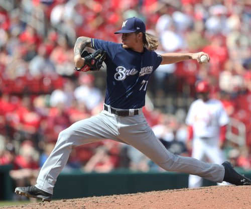 Brewers aim to take down Marlins, rookie pitcher