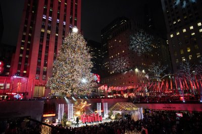 Thousands gather for annual lighting of Rockefeller Center Christmas tree