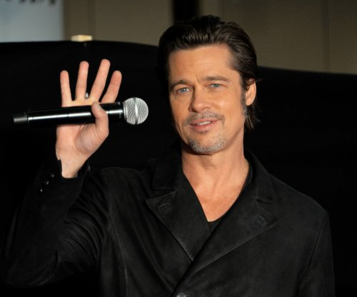 Brad Pitt says running in flip-flops led to fall and facial bruises