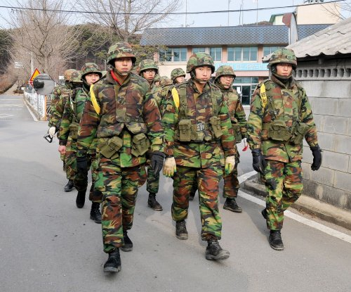 North Korea warns South, reminds Seoul of island shelling incident