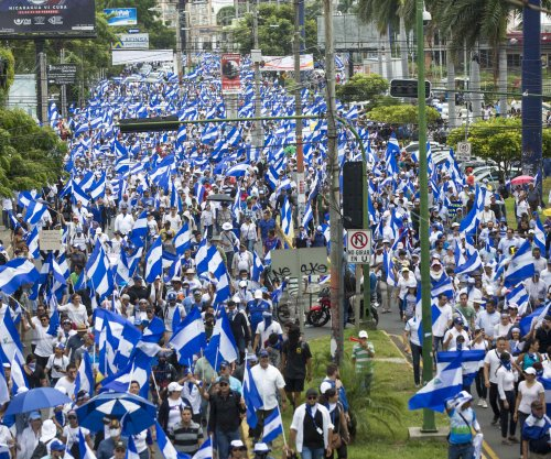 At least one dead as Nicaraguan protesters hole up in church