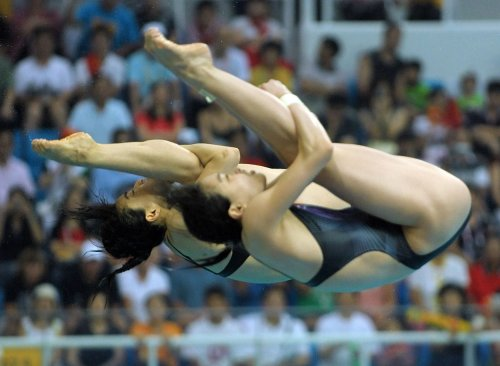 Chinese domination begins in diving