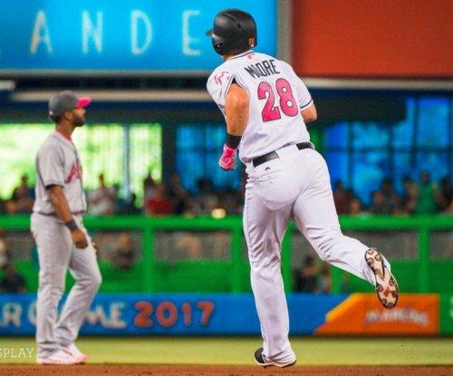 Tyler Moore's 3-run pinch homer lifts Miami Marlins over Atlanta Braves