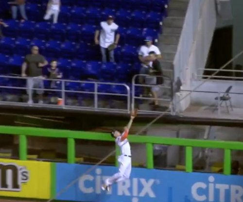 Miami Marlins' Giancarlo Stanton robs home run for last out