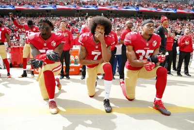 San Francisco 49ers safety Eric Reid reacts to Mike Pence leaving Lucas Oil Stadium
