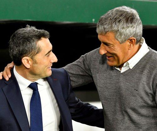Barcelona fires manager Ernesto Valverde, hires Quique Setien