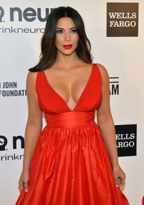 Kim Kardashian looked red hot at Elton John's Oscars party