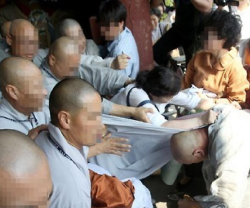 Buddhist monks clash in South Korea over head monk accusations