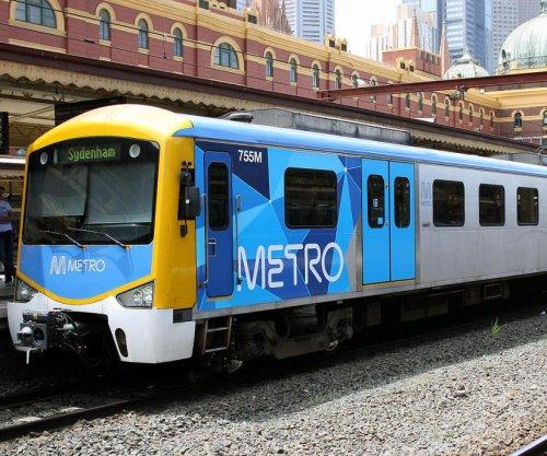 'Train surfing' teens cling to back of Australian train
