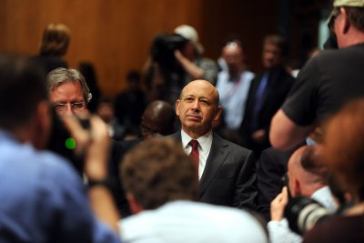 Blankfein at Goldman to keep both jobs