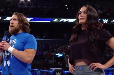 WWE Smackdown: Bella attacks The Miz, New Day win titles