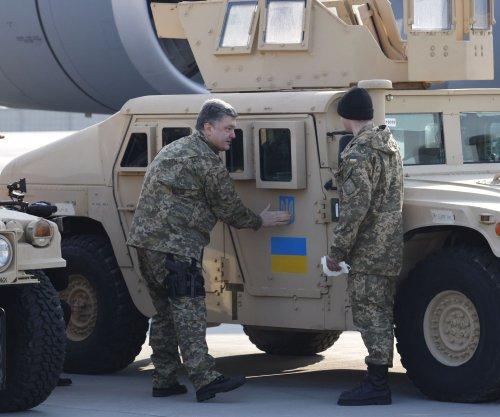 Five deaths, artillery fire disrupt Ukraine ceasefire