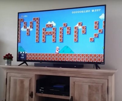 Man proposes to girlfriend using custom Mario level