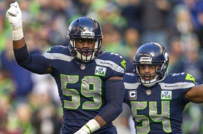 Seahawks win ugly, survive Cardinals upset bid