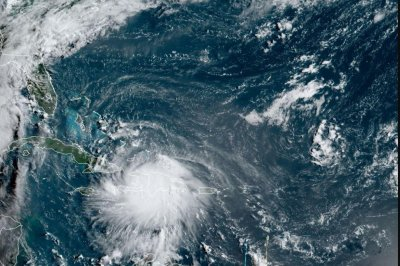 Tropical Storm Laura soaking northern Caribbean, sets course for U.S.