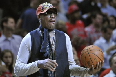 Former NBA star Dennis Rodman charged in hit-and-run