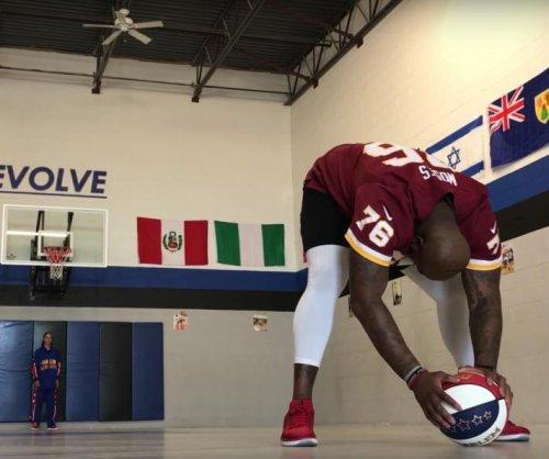 NFL offensive lineman joins Harlem Globetrotters