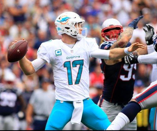 NFL notebook: Miami Dolphins QB Ryan Tannehill suffers knee injury