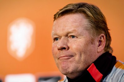 Barcelona hires ex-player Koeman to replace fired manager Setien