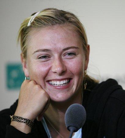 Sharapova returns with a three-set win
