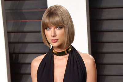 Taylor Swift releases extended version of mysterious snake video