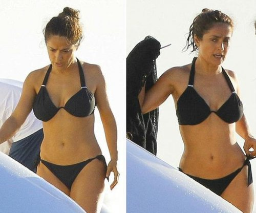 Salma Hayek shows off toned body in black bikini
