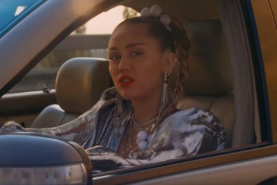 Miley Cyrus evades police in video for 'Nothing Breaks Like a Heart'