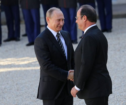 Putin cancels France trip after Hollande calls Russia's Syria actions 'war crimes'