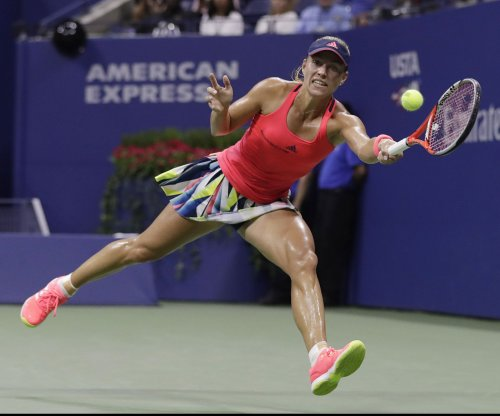 Angelique Kerber celebrates birthday by advancing in Australia