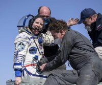 NASA astronaut, cosmonauts, land back on earth from ISS