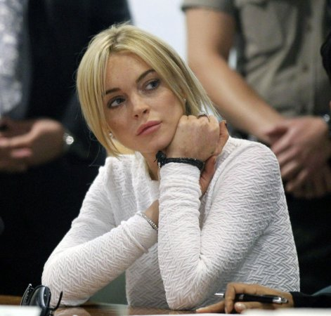 Lohan appears in 'Humpilates' clip